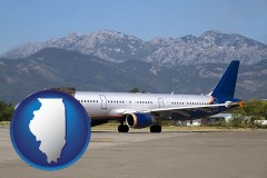 illinois commercial aircraft at an airport, with mountainous background
