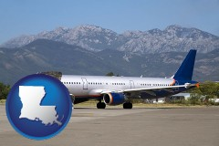 louisiana commercial aircraft at an airport, with mountainous background