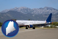 maine commercial aircraft at an airport, with mountainous background