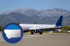 montana commercial aircraft at an airport, with mountainous background