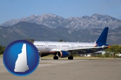 new-hampshire commercial aircraft at an airport, with mountainous background