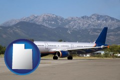 utah commercial aircraft at an airport, with mountainous background