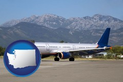 washington commercial aircraft at an airport, with mountainous background