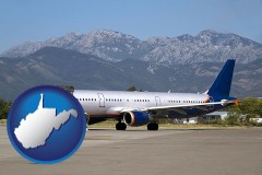 west-virginia commercial aircraft at an airport, with mountainous background