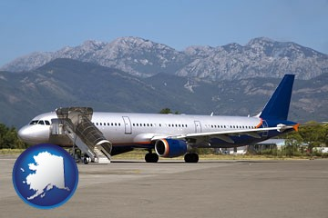 commercial aircraft at an airport, with mountainous background - with Alaska icon