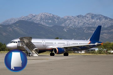 commercial aircraft at an airport, with mountainous background - with Alabama icon