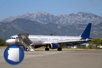 commercial aircraft at an airport, with mountainous background - with Arizona icon
