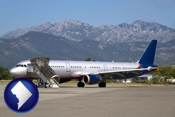 commercial aircraft at an airport, with mountainous background - with Washington, DC icon