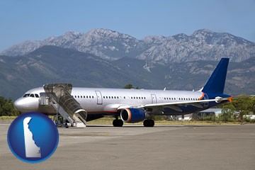 commercial aircraft at an airport, with mountainous background - with Delaware icon