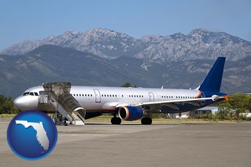 commercial aircraft at an airport, with mountainous background - with Florida icon