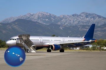 commercial aircraft at an airport, with mountainous background - with Hawaii icon