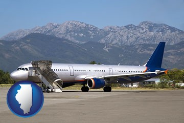 commercial aircraft at an airport, with mountainous background - with Illinois icon