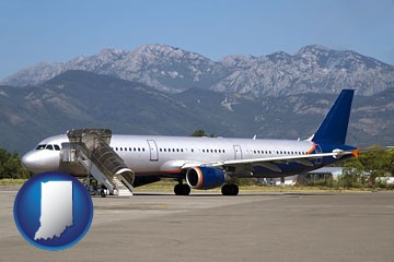 commercial aircraft at an airport, with mountainous background - with Indiana icon