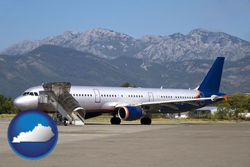 commercial aircraft at an airport, with mountainous background - with Kentucky icon