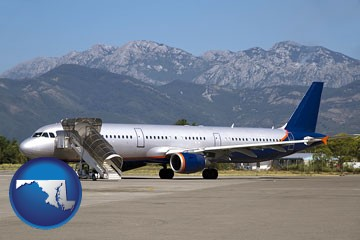 commercial aircraft at an airport, with mountainous background - with Maryland icon