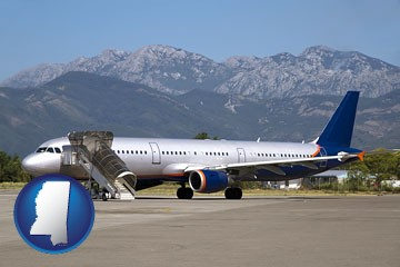 commercial aircraft at an airport, with mountainous background - with Mississippi icon