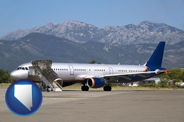 commercial aircraft at an airport, with mountainous background - with Nevada icon