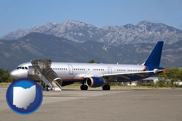 commercial aircraft at an airport, with mountainous background - with Ohio icon