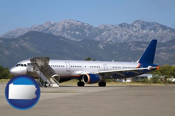 commercial aircraft at an airport, with mountainous background - with Pennsylvania icon