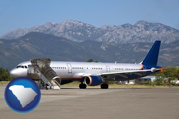 commercial aircraft at an airport, with mountainous background - with South Carolina icon