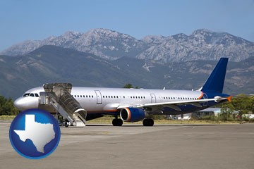 commercial aircraft at an airport, with mountainous background - with Texas icon