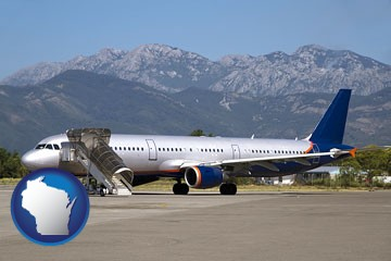 commercial aircraft at an airport, with mountainous background - with Wisconsin icon