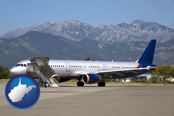 commercial aircraft at an airport, with mountainous background - with West Virginia icon