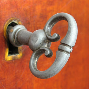 an antique furniture key