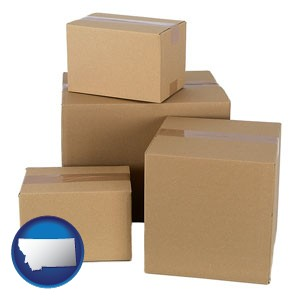 a stack of cardboard boxes - with Montana icon