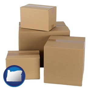 a stack of cardboard boxes - with Oregon icon