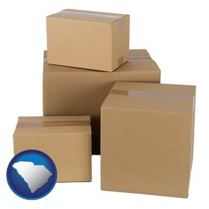 a stack of cardboard boxes - with South Carolina icon