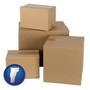 a stack of cardboard boxes - with Vermont icon