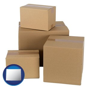 a stack of cardboard boxes - with Wyoming icon