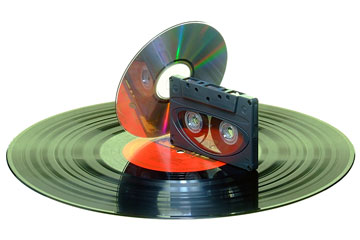 an audio compact disc, a compact cassette, and a vinyl record