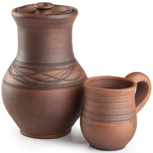 a brown clay pottery jar and cup
