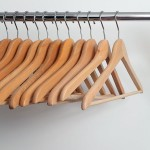 a closet rod and wood clothes hangers