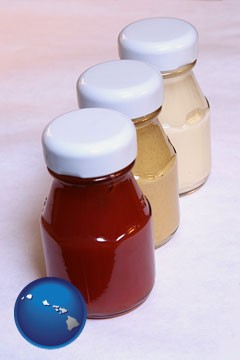ketchup, mustard, and mayonnaise condiments - with Hawaii icon