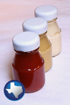 ketchup, mustard, and mayonnaise condiments - with Texas icon