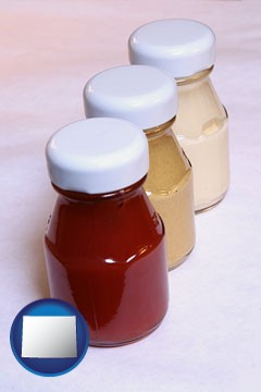 ketchup, mustard, and mayonnaise condiments - with Wyoming icon