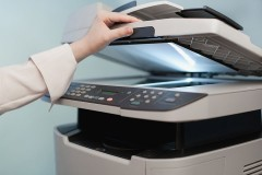 a woman using a photocopier