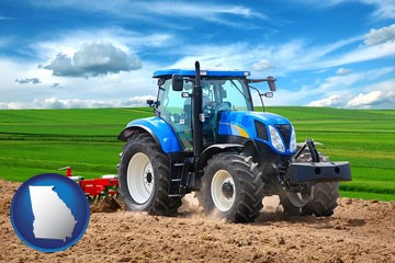 a blue farm tractor and a red cultivator - with Georgia icon