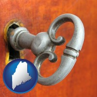 maine map icon and an antique furniture key