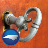 north-carolina map icon and an antique furniture key