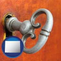 wyoming map icon and an antique furniture key