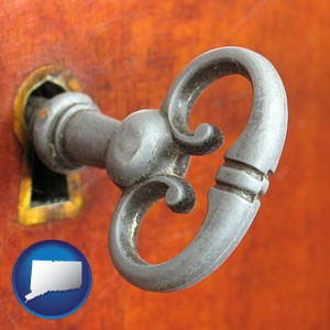 an antique furniture key - with Connecticut icon