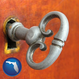 an antique furniture key - with Florida icon
