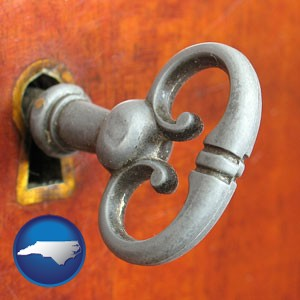 an antique furniture key - with North Carolina icon