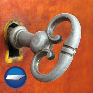 an antique furniture key - with Tennessee icon