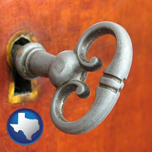 an antique furniture key - with Texas icon