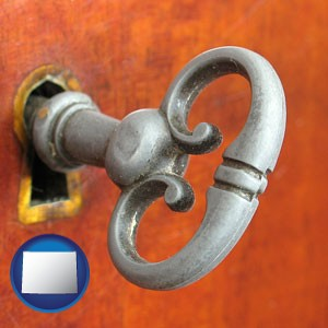 an antique furniture key - with Wyoming icon